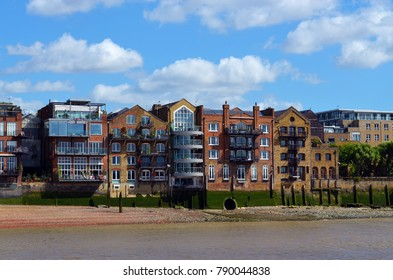 View to the shore development of the Thames at low water - London, Great Britain - 08/04/2015