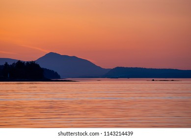 View of the shore of Vancouver Island from the Salish sea at sunset time