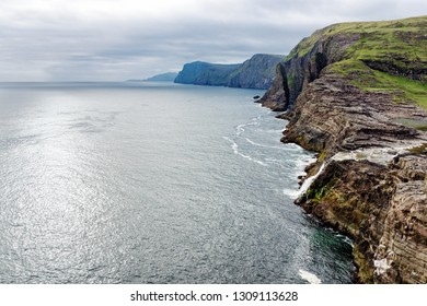View of shore with waterfall and rocks on Faroe islands, Denmark