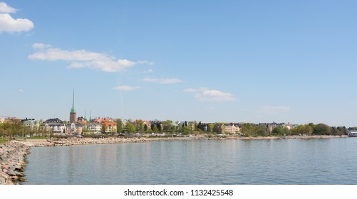 View from the shoreline of Munkkisaari district, across the water to Pyhän Birgitan Park in Eira District, Helsinki, Finland