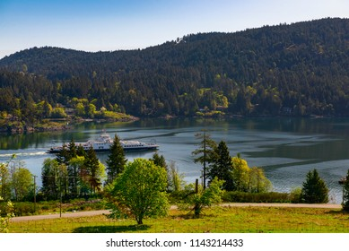 View of the shoreline of Salt Spring Island with ferry crusing the water, British Columbia, Canada
