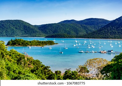 View of Shute Harbour, islands and Conway National Park, from the mainland at Shute Haven, The Whitsundays, Queensland, Australia.  Yachts moored. Tropical climate. The Tropics. Copy space.