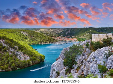 View from the Sibenik Bridge a long concrete arch bridge passing through the canyon of the Krka River on Skradin town. Location Skradin town, Croatia, Europe. Scenic image of travel destination.