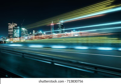 View from Side of flyover,blurred motion effect  with light trails and beautiful city skyline background .