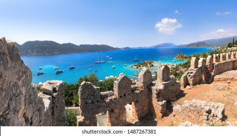 View of Simena Castle, Kaleköy, and Kekova with a turquoise sea in the summertime.Simena / Kekova / Demre / Antalya