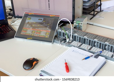 View of the simple programmable logic controller (PLC) on the table in the office. It is an industrial computer control system that continuously monitors the state of input devices.