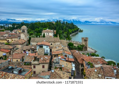 View of Sirmione, a small town located on the Sirmio peninsula, and Lake Garda, one of the most picturesque lakes in the Northern Italy. The beautiful panorama was captured from the Scaligero Castle