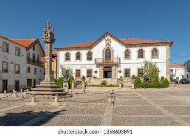 View of the sixteenth century gothic manueline style granite pillory and the city hall building of Vila Nova de Foz Coa, Portugal