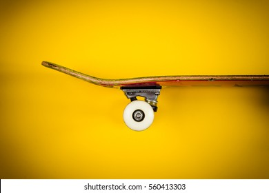 view of the skateboard on a yellow background