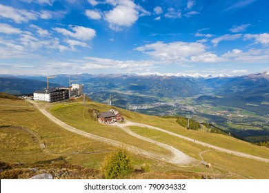 View of Ski lift on mountain at Kronplatz, with view of mountain range and blue sky, South Tyrol, Italy
