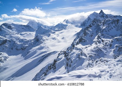 view of ski resort in mountains. Ski slopes. Rest in mountains in the winter. Skiing and snowboards.