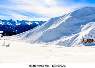 View of ski slope and amazing Austrian Alps mountains in beautiful winter snow, Serfaus Fiss Ladis, Tirol, Austria