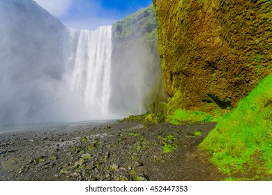 View of the Skogafoss waterfall, with a rainbow, on the Skoga River, in south Iceland