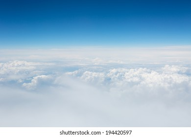view of the sky and clouds from the airplane
