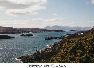 View of Skye Bridge and a small coastal village on Isle of Skye, Scotland, on a sunny day. View from Kyle of Lochalsh.