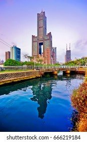 View of the skyline along a river at dusk in Kaohsiung, Taiwan