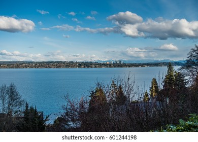 A view of the skyline of Bellevue, Washington with the Cascade Mountains behind.