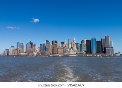 View To Skyline Of Manhattan At Sunny Day From Water / New York