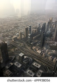 The view from the skyscraper down on the city at sunset in Dubai