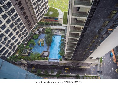 View from the skyscraper at rain and pool