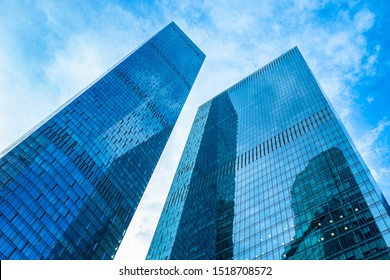 View of skyscrapers from below. Skyscrapers against the blue sky. Tall building. Business center of the city. Modern urban architecture. Houses made of glass and concrete.