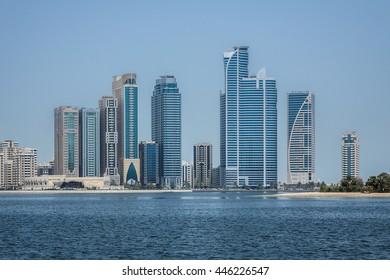 View of skyscrapers in Khalid Lagoon in Sharjah city. Sharjah located along northern coast of Persian Gulf on Arabian Peninsula. United Arab Emirates.