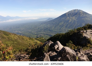 View of the slope of the volcano Mirapi and a mountain Merbabu