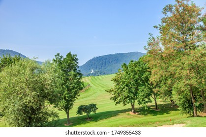 A view of a sloping field of Zlati Gric Golf Course with trees on a sunny day in Slovenia - Shutterstock ID 1749355433