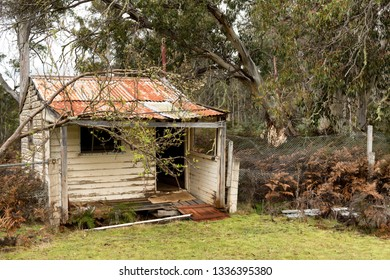 View of small abandoned and derelict timber weaterboard hut in the central highlands of Tasmania