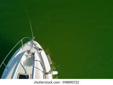 View of small boat cruiser in the ocean from above. Room for Copy