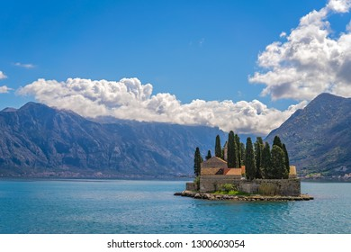 View of the small Church on San George`s island in Kotor bay as seen from the boat sailing away, Montenegro