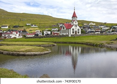 View of the small church of Sandavagur, on the south coast of the island of Vagar, Faroe Islands. Sandavagur means beach bay. The town is situated on the only road on the island.