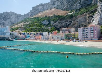 View of small fishing village and sandy beach at Catalan Bay (La Caleta). British Overseas Territory of Gibraltar.