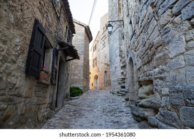 View of small flawlessly preserved medieval village Lacoste, in the Luberon region of Provence, with winding steep and narrow cobbled streets paved in calade stone and authentic stone houses