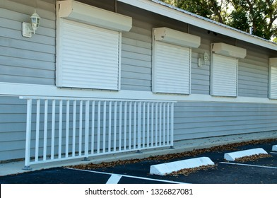 View of small generic florida building with hurricane shutters closed.