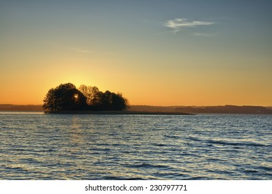View of small island on a lake during sunrise, Mazury, Poland