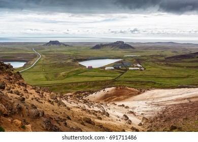 View of small lakes on a background of mountains under cloudy sky in Iceland.
