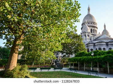 View of a small square garden in Montmartre, Paris, France, with the Sacre-Coeur basilica (Basilica of the Sacred Heart of Paris)