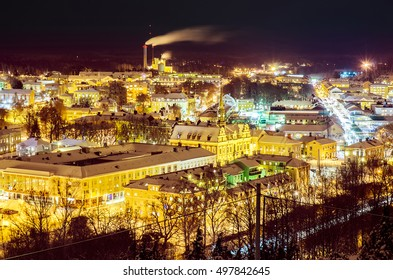 View of small swedish european town Soderhamn at night, industrial background with evening illumination