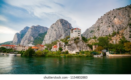 view of the small town Omis on the river Cetina surrounded with mountains, Makarska Riviera, Croatia