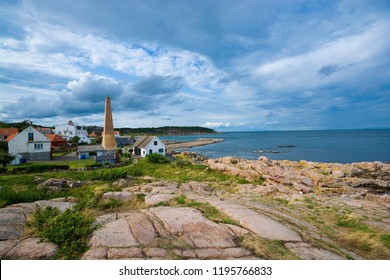 View of small town on beautiful stony coast of Bornholm island - Sandvig, Denmark