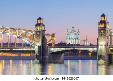 """View of the Smolny Cathedral and the Bolsheokhtinsky bridge during the White Nights in June. The inscription on the bridge """"Bridge of Peter the Great"""". St. Petersburg. Russia"""