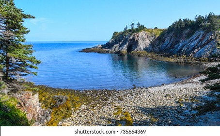 A view of Smuggler's Cove in Meteghan, Nova Scotia, Canada with the tide low showing the rocky beach