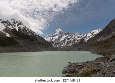 View of snow capped Mount Cook with Hooker Lake in the foreground and the Hooker Glacier in the middle ground. Aoraki/Mount Cook National Park, Canterbury, New Zealand.