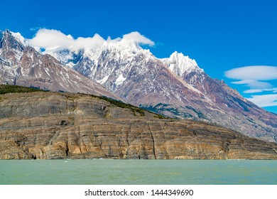 View of the snow capped rock mountain at Lake Grey in Torres del Paine National Park, Chile