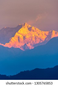 A view of Snow clad Kangchenjunga Peak, also spelled Kanchenjunga, is the third highest mountain in the world. It lies between Nepal and Sikkim, India,