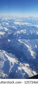 View at snow covered Alpes mountainous froman airplane