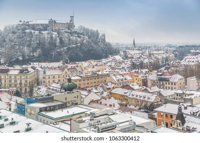 View of snow covered Ljubljana old town and Castle from The Skyscraper, Ljubljana, Slovenia, Europe 12-12-2017