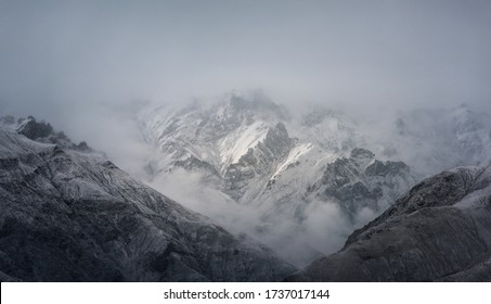 View of snow mountain surrounded by clouds with morning fog