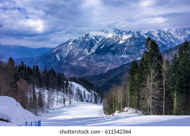 View of the snow-capped mountain peaks and the ski slope of the resort of Gazprom in Sochi, Russia